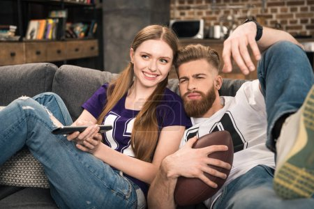 couple watching sports game