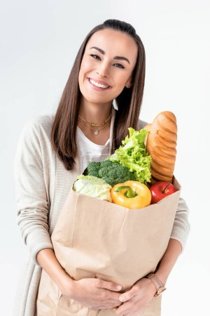 woman holding grocery bag