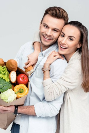 Couple with grocery bag