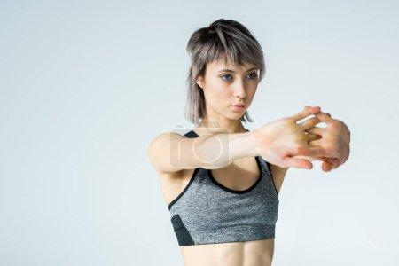 Young sportswoman training
