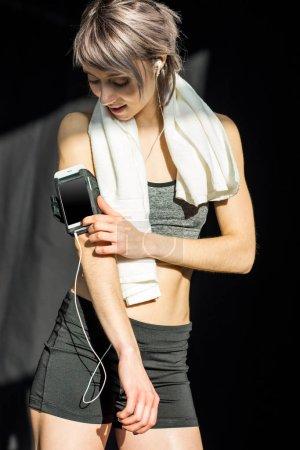 sporty woman listening music