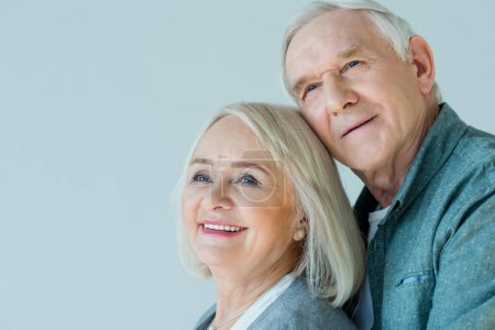 Photo for Portrait of happy senior man and woman on grey - Royalty Free Image