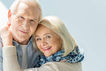 Photo for Portrait of smiling hugging senior couple on white - Royalty Free Image