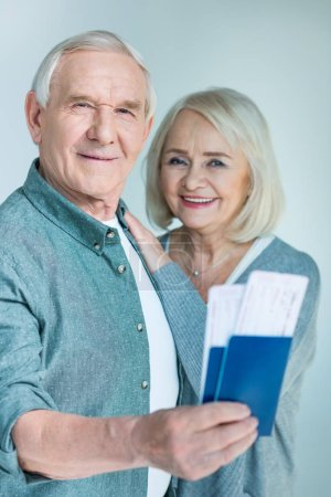 senior couple with passports and tickets