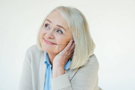 Photo for Portrait of dreamy senior woman on white - Royalty Free Image