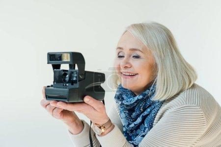 senior woman with retro camera