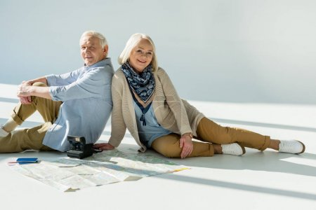Senior couple with traveling map