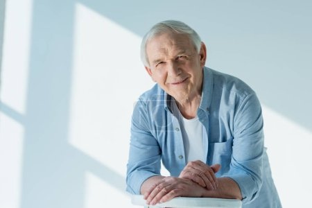 Photo for Portrait of smiling senior man in casual shirt on white - Royalty Free Image