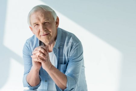 Photo for Portrait of pensive senior man in stylish shirt on white - Royalty Free Image