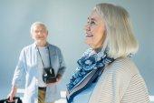 Senior couple with retro camera