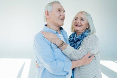 Photo for Portrait of happy senior couple hugging on white - Royalty Free Image