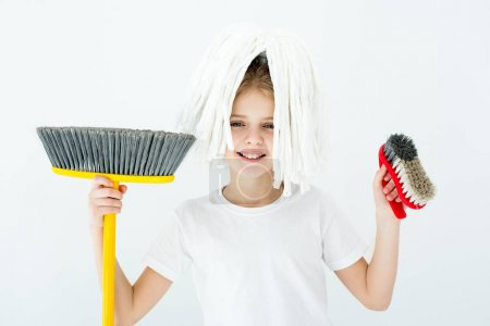 girl holding cleaning supplies