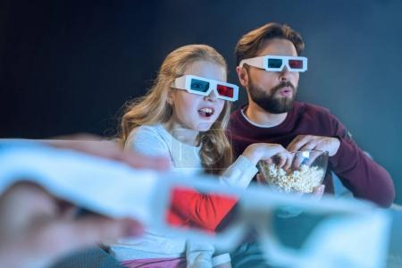 Father and daughter in 3d glasses