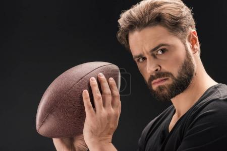 man with rugby ball