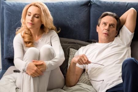 Upset middle aged couple