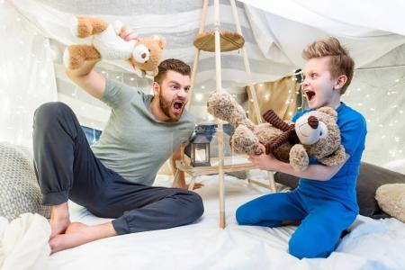 Father and son in blanket fort