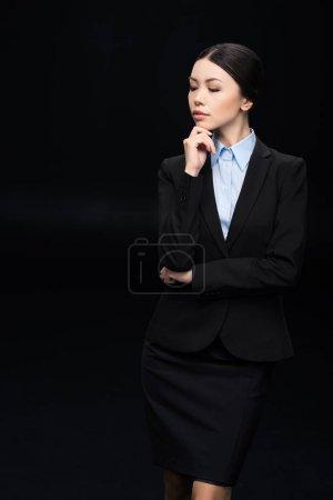 pensive businesswoman in black suit