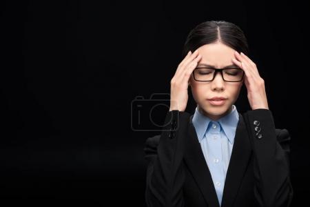 brunette businesswoman with headache