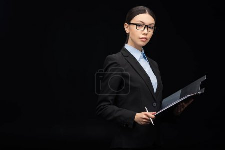 brunette businesswoman with clipboard