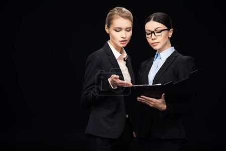 businesswomen connecting and holding clipboard