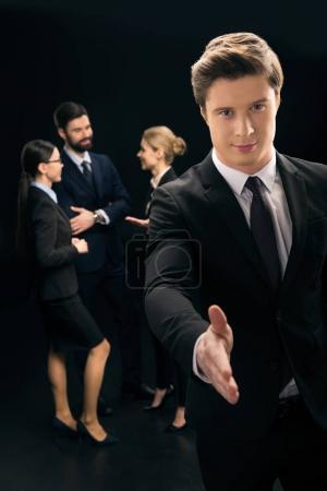businessman showing handshake sign