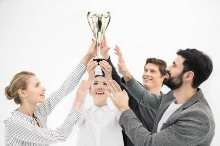 Photo for Happy business people holding goblet isolated on white, business teamwork concept - Royalty Free Image