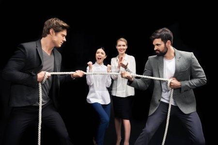 businessmen pulling over rope