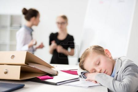 Little boy dreaming on table
