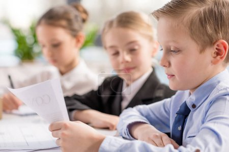 Little boy reading contract