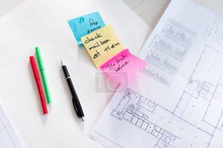 architectural blueprint and  sticky notes