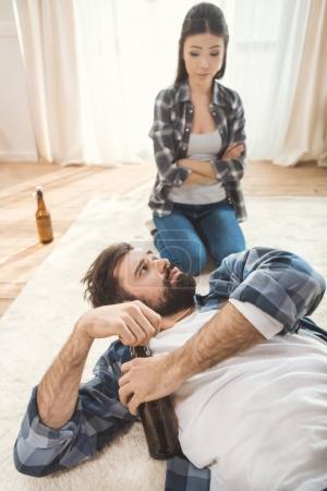 Woman shouting on drunk man