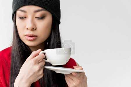 asian woman with tea cup