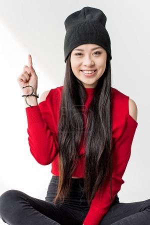 asian woman pointing up