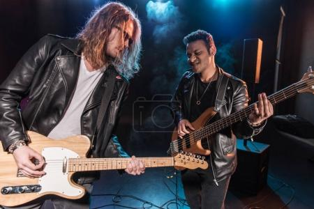 Photo for Electric guitar players performing hard rock music on stage - Royalty Free Image