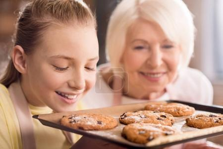 Grandmother and grandchild with cookies