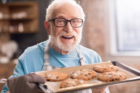 Senior man with cookies