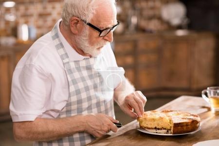 Man cutting homemade pie