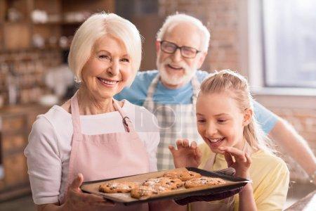 girl looking at homemade cookies