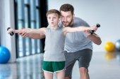 Boy training with coach