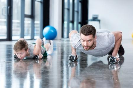 Man and boy doing push ups