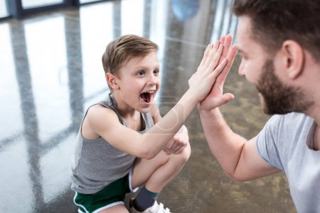 Boy giving high five