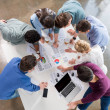 Overhead view of professional businesspeople discu...