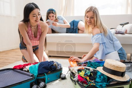 women packing suitcases