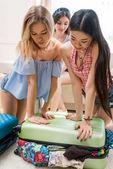 Women packing suitcase