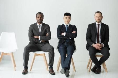 multicultural businessmen sitting