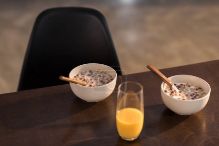 Photo for Breakfast at home with orange juice and corn flakes with milk - Royalty Free Image