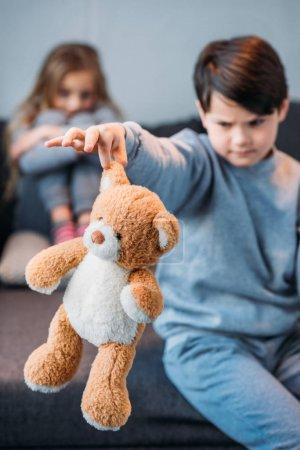 boy holding teddy bear