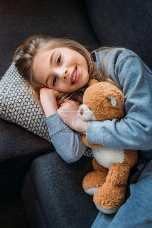 Little girl with teddy bear