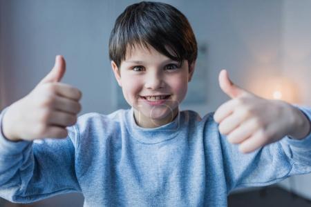 Little boy gesturing  thumbs up