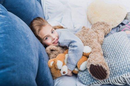 Little girl with teddy bears